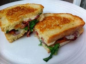 Grilled Fontina Cheese with bacon, arugula and red onion