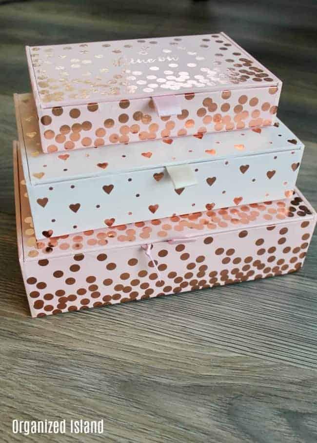 How to Organize Keepsakes- pink storage boxes