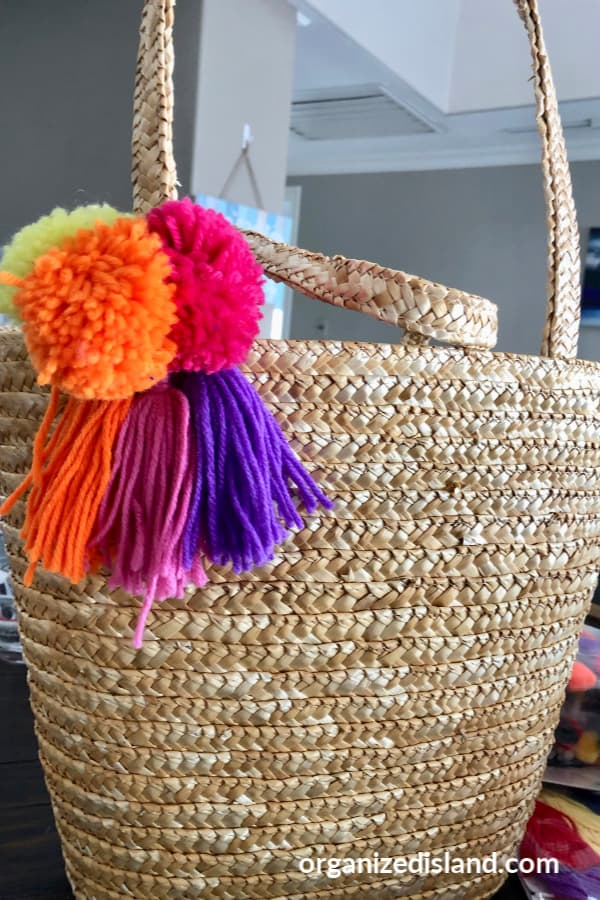 tote bag with pom poms and tassels