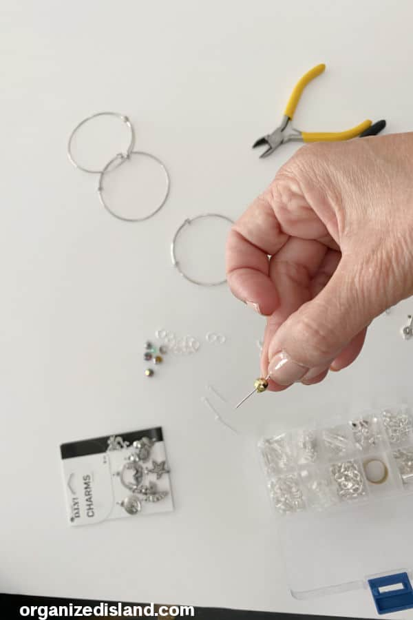 Using open eye beading pin