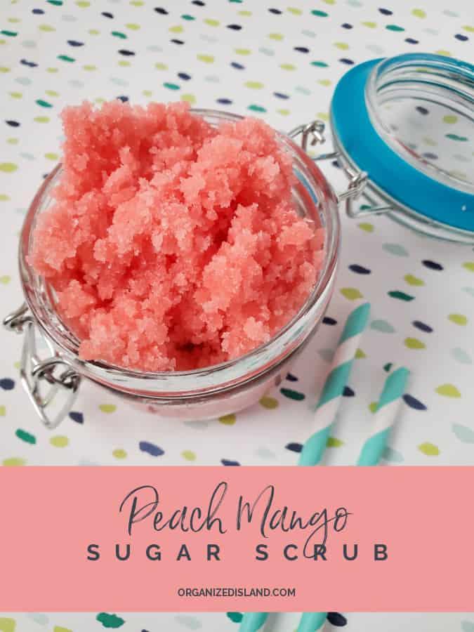 Peach Mango Sugar Scrub in a glass jar, on a dotted table cloth