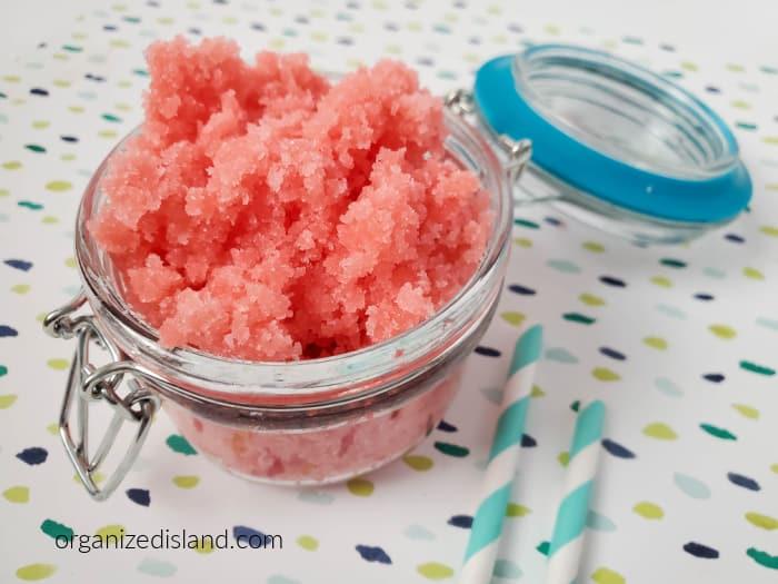 Peach Mango Sugar Scrub in a glass jar with an airtight lid