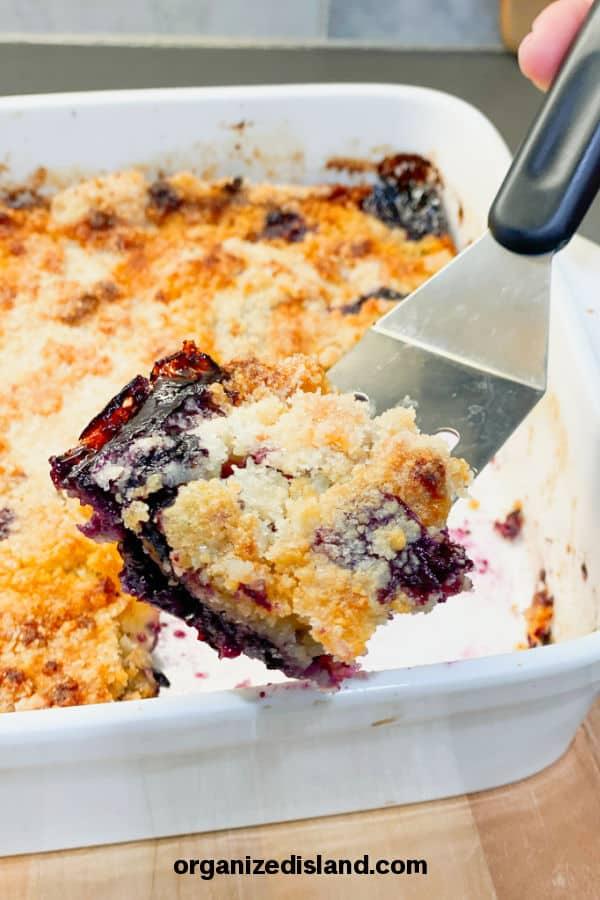 blueberry crisp slice on spatula