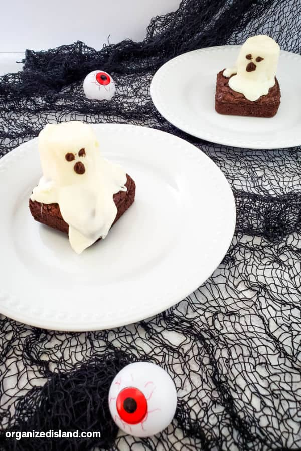Halloween Brownies with ghosts on top on plate