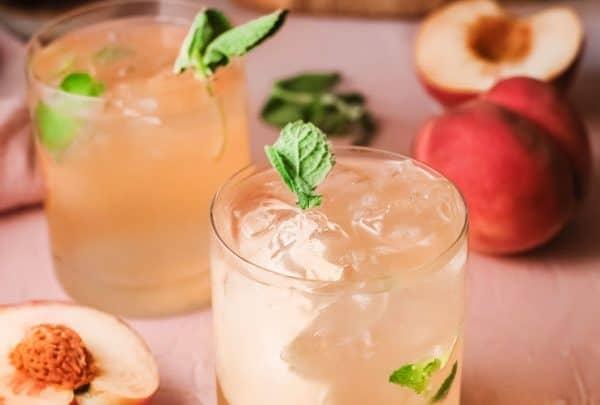 peach flavored bourbon smash in glass