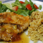 Apricot glazed pork chop recipe made on a stovetop. Perfect for a weeknight dinner.