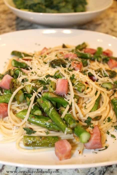 This ham and asparagusi spaghetti is made with asparagus, spaghetti and cheese is a delicious way to use leftover ham! This recipe is from scratch and does not have soup in it.
