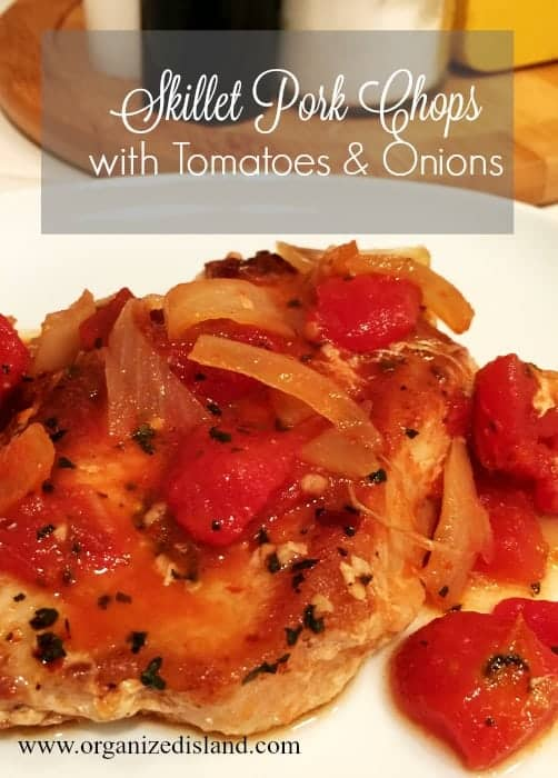 These skillet pork chops with tomatoes are an easy dinner idea for succulent pork chops!