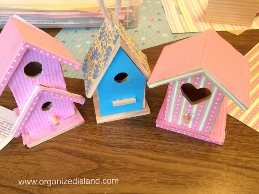 Cute craft idea decorating bird houses using wooden bird houses , scrapbook paper and washi tape!