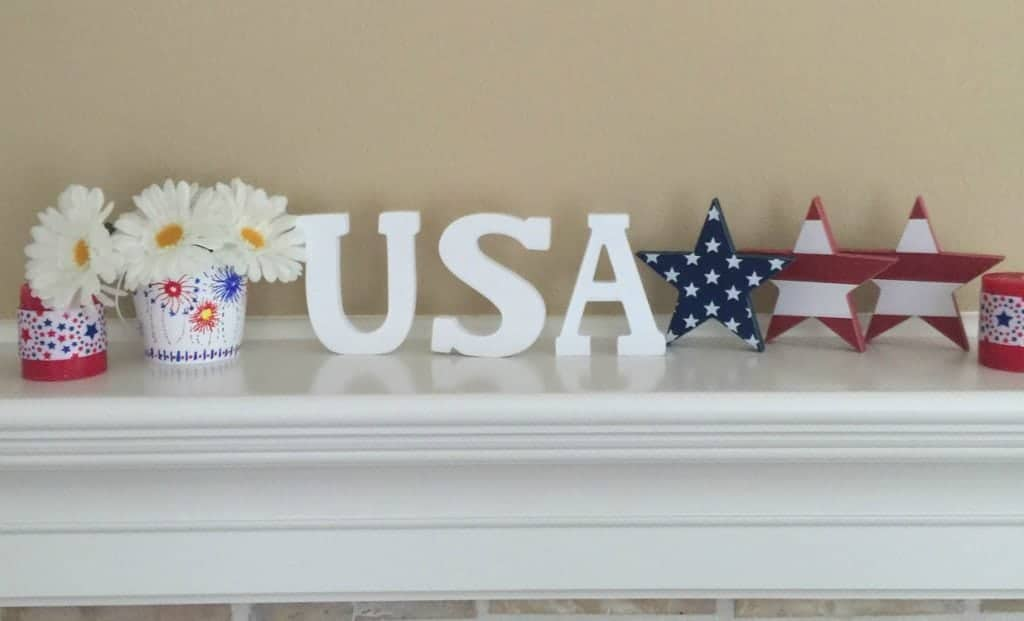 This inexpensive 4th of July mantle was made from dollar bin items. See how to design one of a kind buckets for your home.