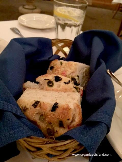 they brought us their freshly baked foccacia bread with oil and vinegar and cheese.