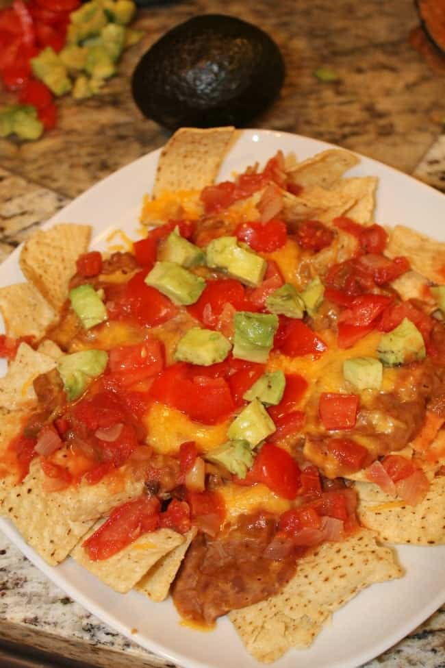 This homemade nacho recipe takes less than 15 minutes to make. Perfect for a quick dinner or lunch idea!