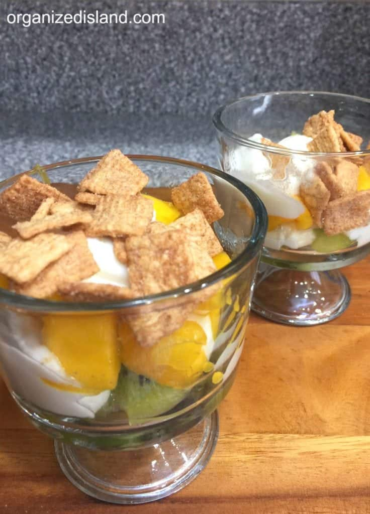 Kiwi Mango Yogurt idea with cereal on top.