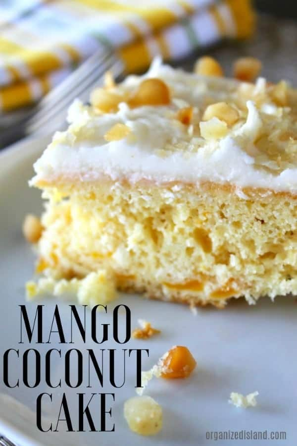 This tasty mango coconut cake is perfect for a summer get together or luau. Rich in flavor, this delightful, light dessert is like summer in a cake. #mango #coconut #cake #dessert #summer #picnic #party #cakes #desserts #macadamia #summer #dessertidea