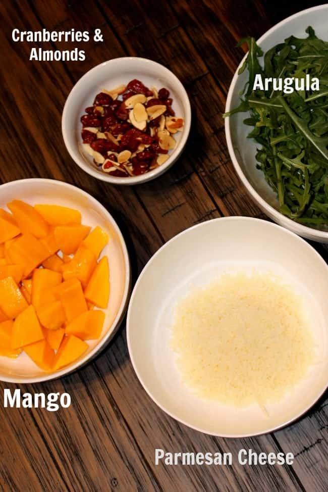Simple and easy Mango Arugula salad recipe that is perfect for spring and summer!
