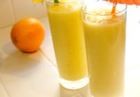 Making a smoothie with orange juice, yogurt and fresh fruit is so easy and delicious!