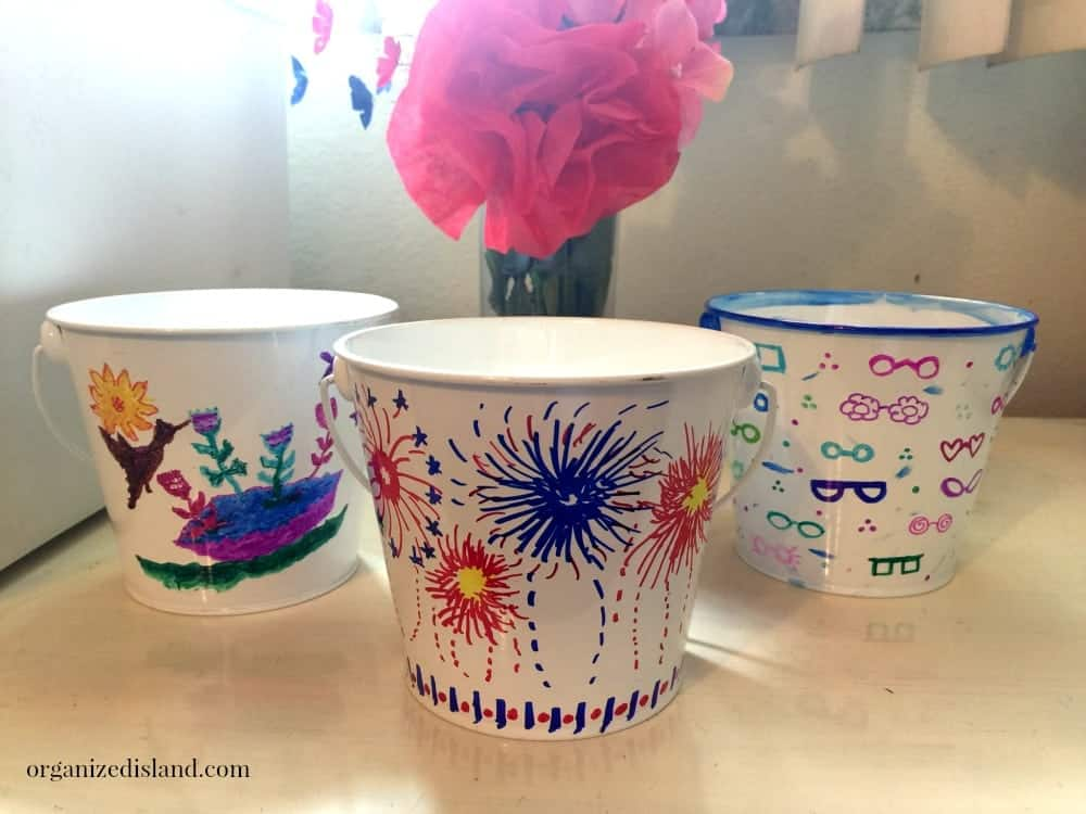 All you need are some dollar bin buckets and some Sharpie markers to make some fun inexpensive Sharpie marker art!