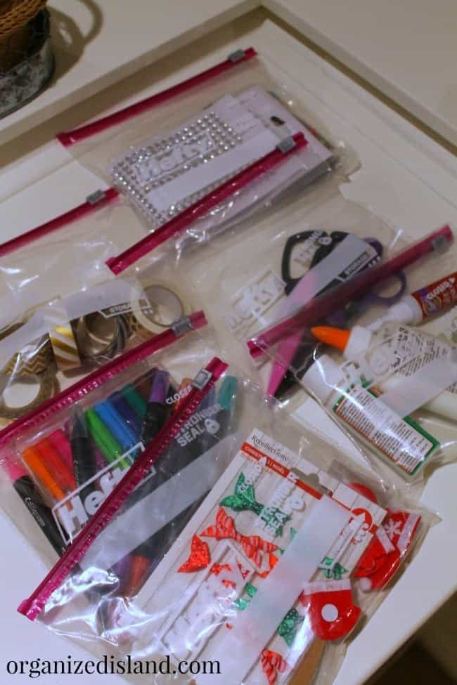 Organizing holiday craft supplies is easy with the help of these baggies. They stay organized and maximize small spaces.