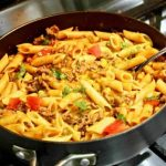 Taco pasta with ground beef comes together in one skillet for a simple weeknight dinner idea.