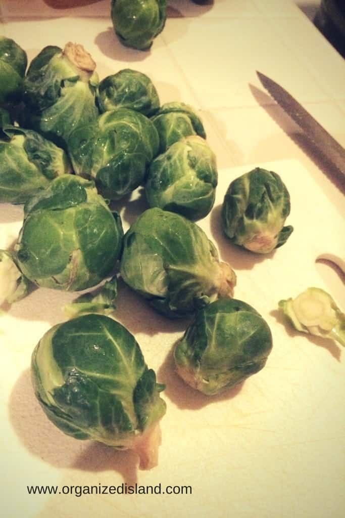 Wash the brussel sprouts with cold water.