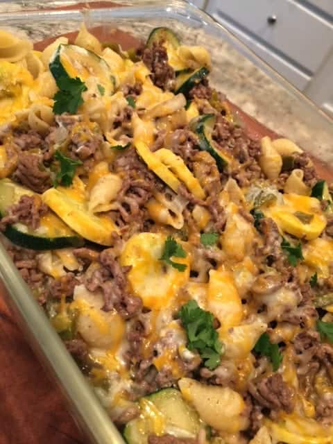 Looking for an easy zucchini casserole recipe? This one is so pretty and tasty with ground beef, seasonings and mushrooms.